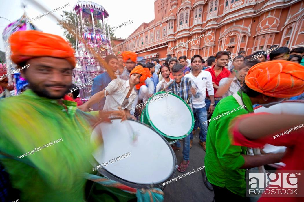 Stock Photo: drummer of the islamic Muharram procession at the Hawa Mahal or Palace of the Winds in Jaipur, Rajasthan, India, Asia.