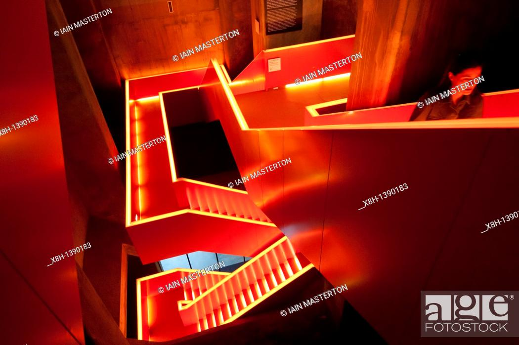 Stock Photo: Internal stairs with red lighting at UNESCO Zollverein museum in former coal mine in Essen Germany.