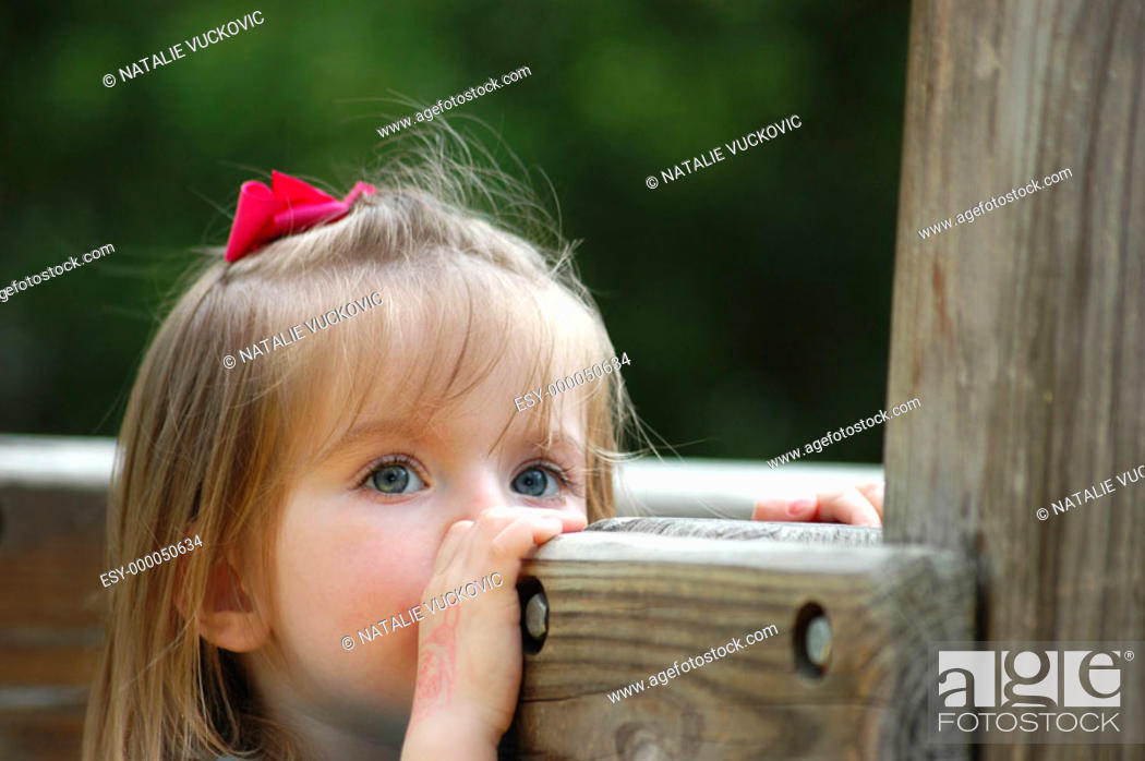Stock Photo: Close up of little girl at park.