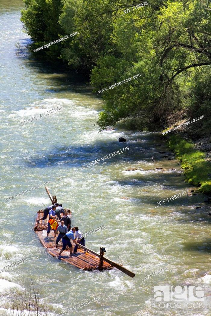 Stock Photo: Rai or almadia raft La Pobla de Segur  Diada dels Raiers ferrymen feast day  Noguera Pallaresa river  Pyrénées  Lleida province  Catalonia  Spain.