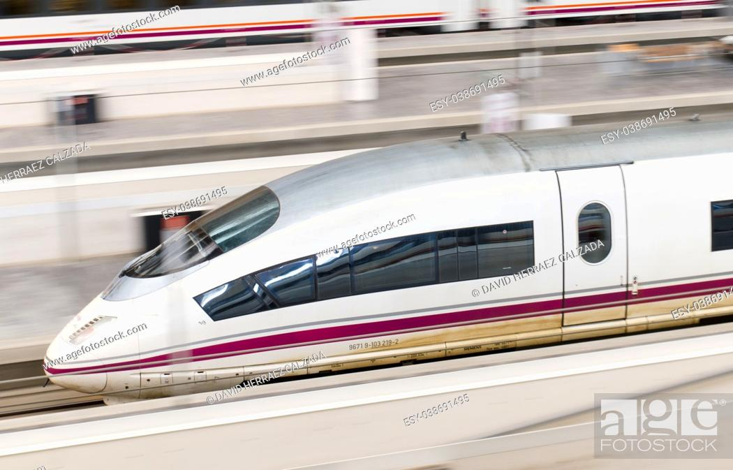 Stock Photo: RENFE - AVE High speed train at Zaragoza Delicias station. AVE is a service of high-speed rail in Spain operated by Renfe Operadora.
