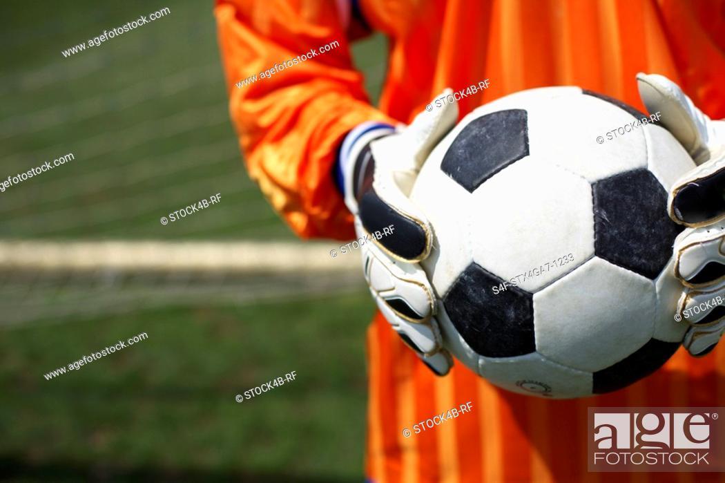Stock Photo: Goalkeeper holding ball.
