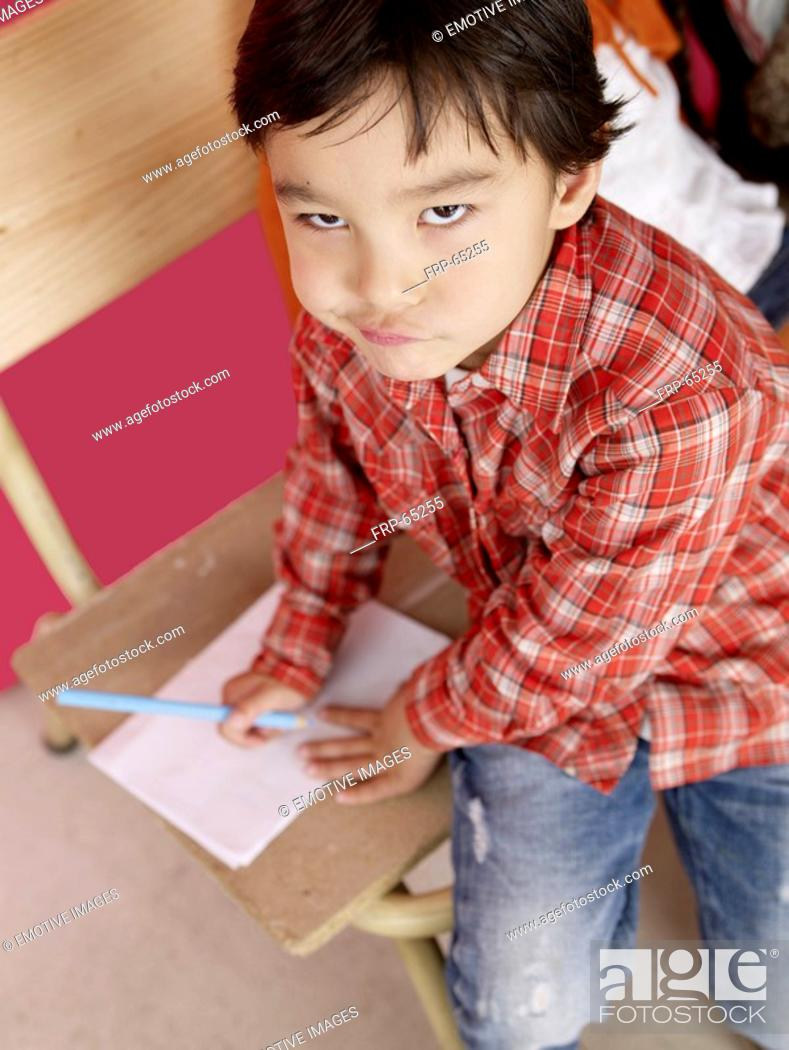 Stock Photo: Asian boy with paper and pen.