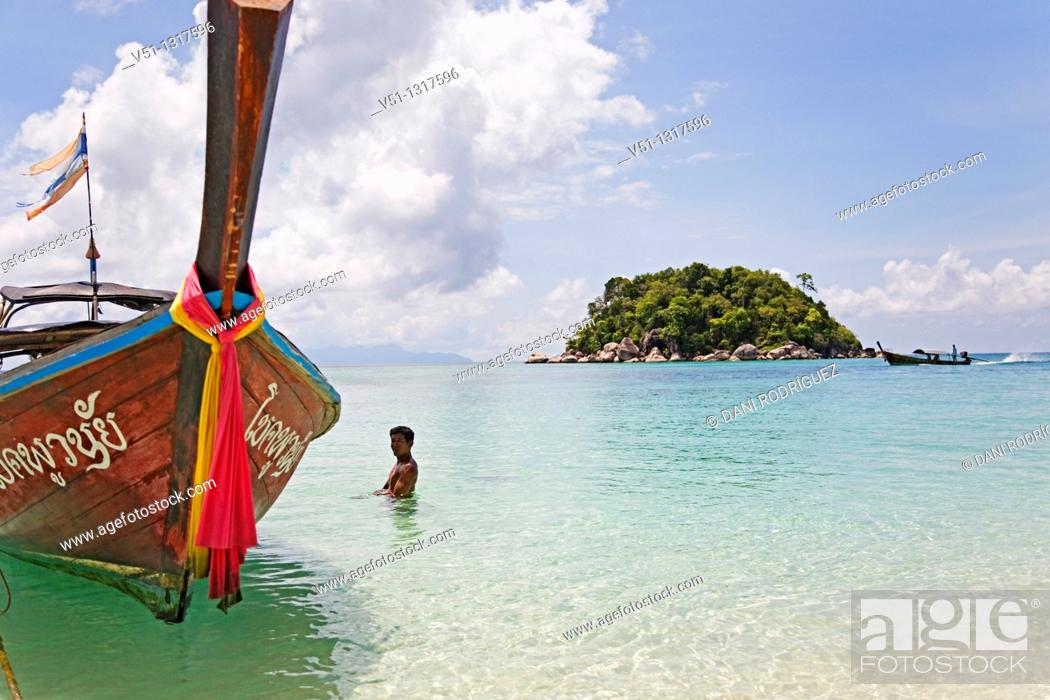 Stock Photo: Traditional boat in a paradise beach in Koh Lipe, Thailand.