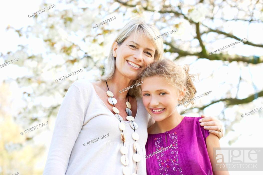 Stock Photo: Smiling mother and daughter hugging.