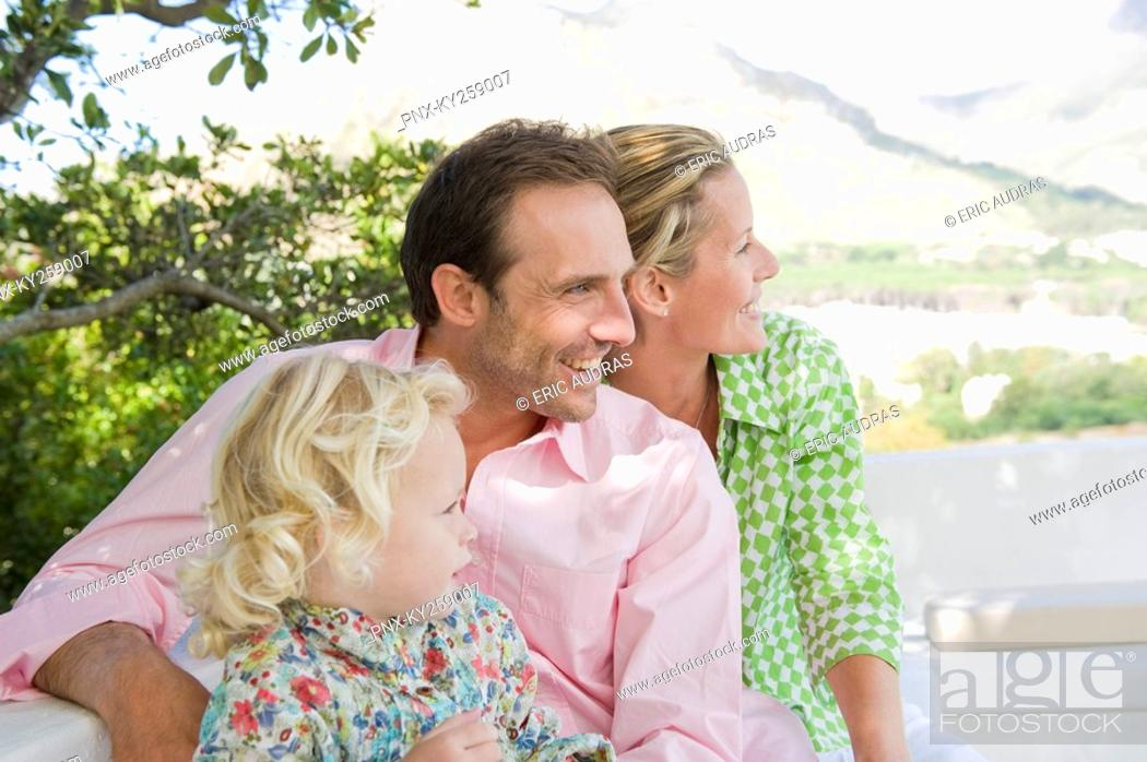 Stock Photo: Family smiling on a terrace.