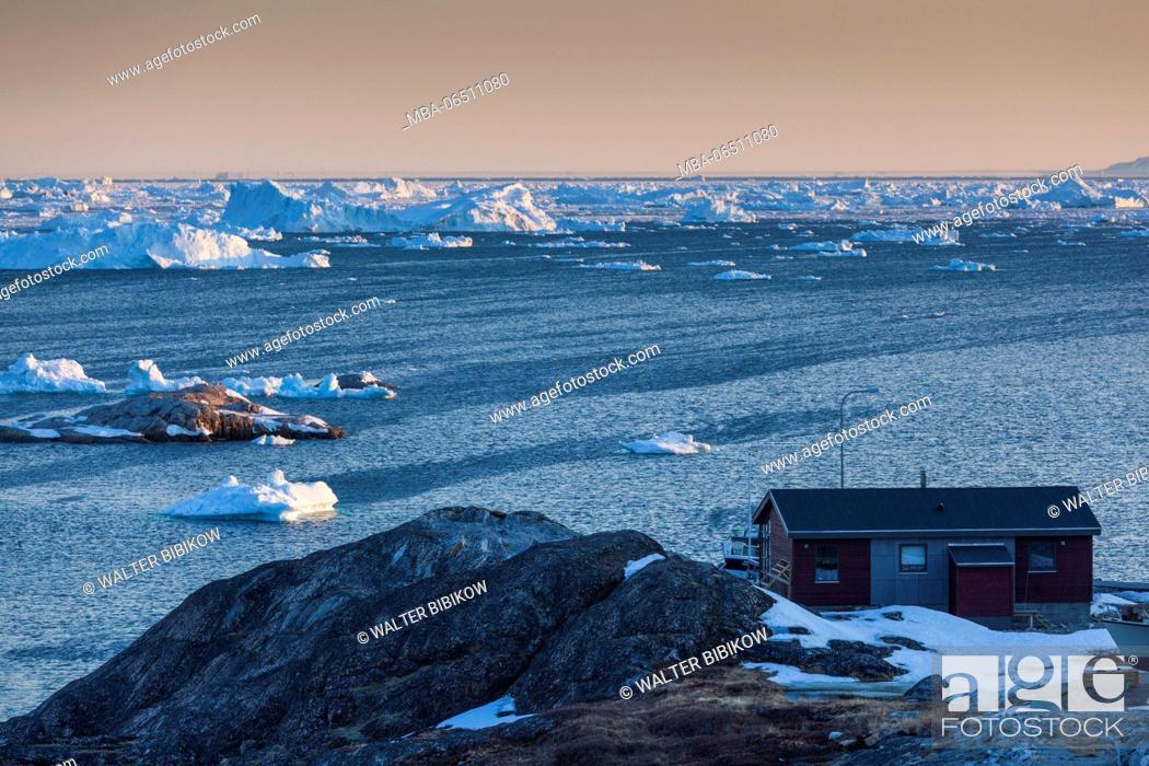 Stock Photo: Greenland, Disko Bay, Ilulissat, floating ice, sunset.