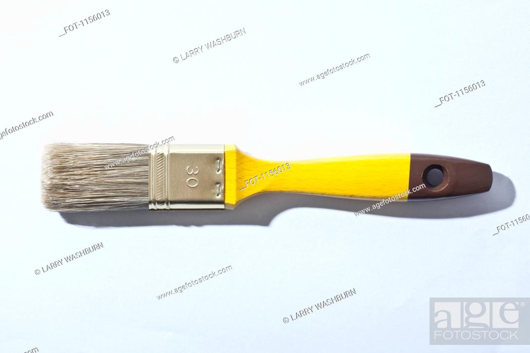 Stock Photo: A clean paintbrush with a bright yellow handle.