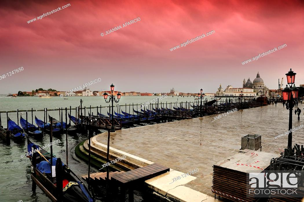 Stock Photo: View of the Grand Canal with a row of moored gondolas on a cloudy day with mauve gradient filter in the sky, Venice, Italy.