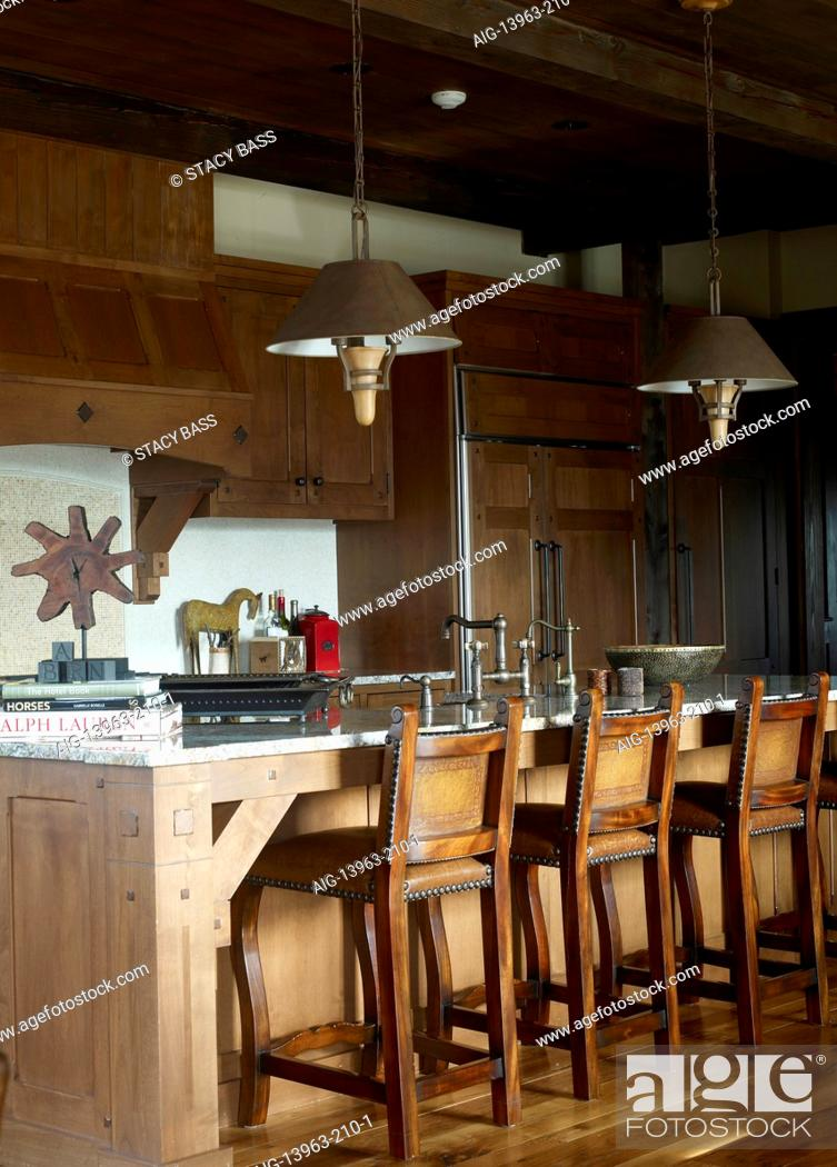 Bar stools at breakfast bar in country style kitchen, USA, Stock ...