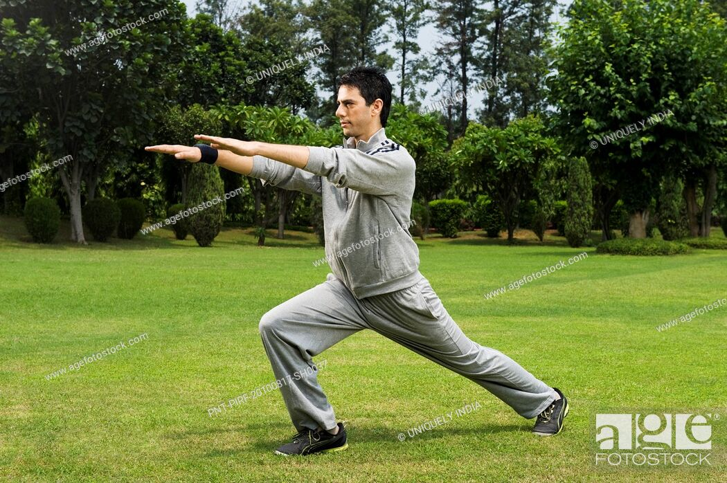 Stock Photo: Man exercising in a park.
