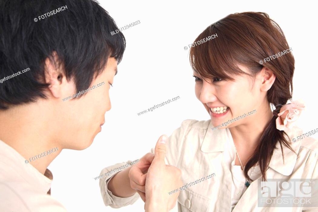 Stock Photo: Couple doing finger wrestling.