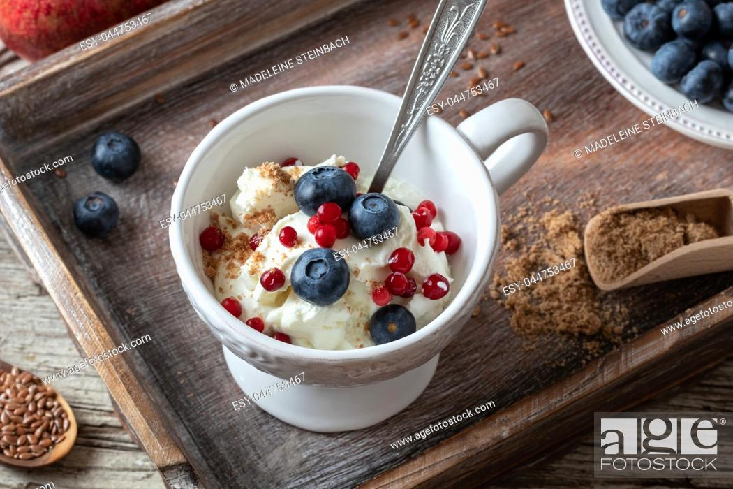 Stock Photo: Cottage cheese with ground flax seeds, blueberries and frozen cranberries.