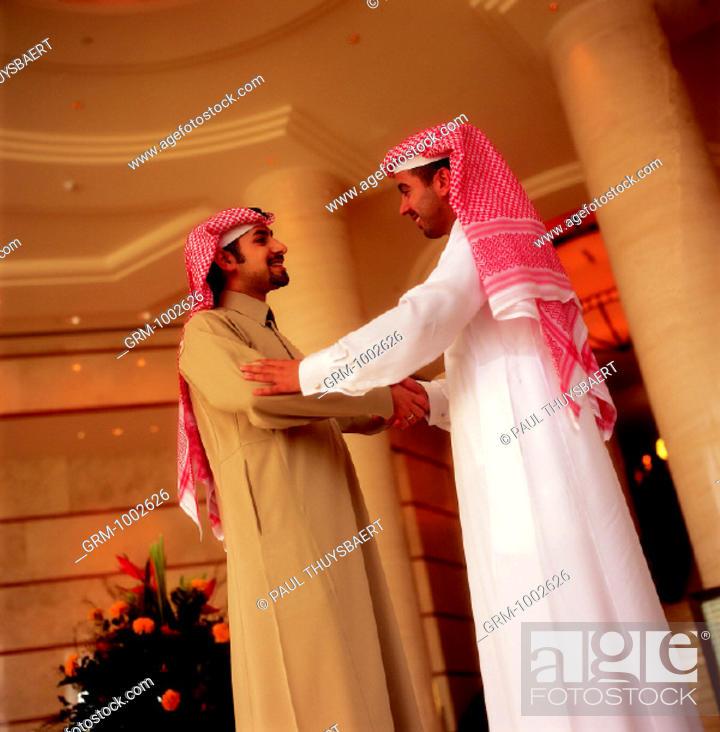 Stock Photo: Handshake between businessmen.