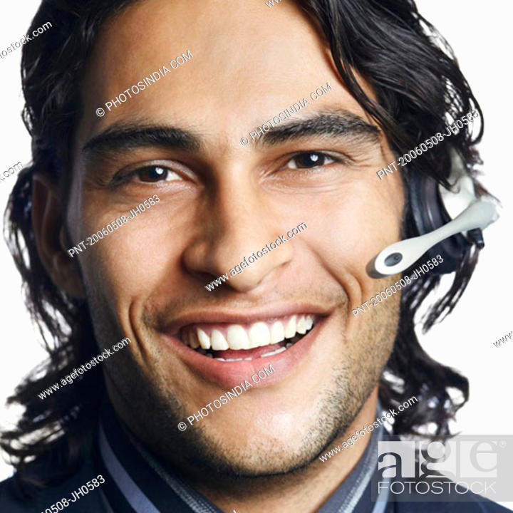 Stock Photo: Portrait of a male customer service representative smiling.