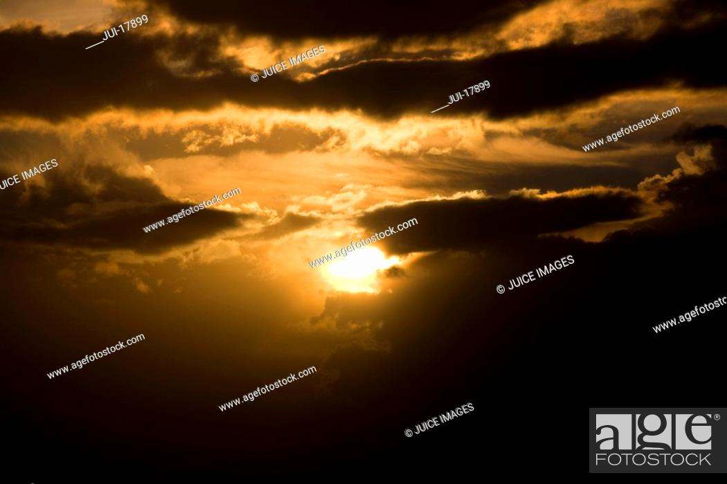 Stock Photo: Sun in cloudy sky.