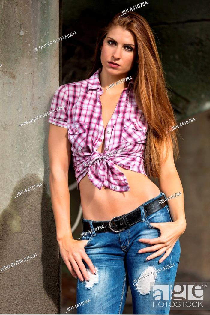 Stock Photo: Young woman with long hair in a checked shirt.