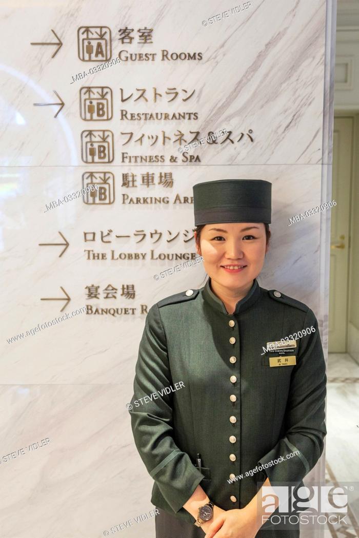 Stock Photo: Japan, Honshu, Tokyo, railway station, Tokyo station, Tokyo station hotel, female doorkeeper,.