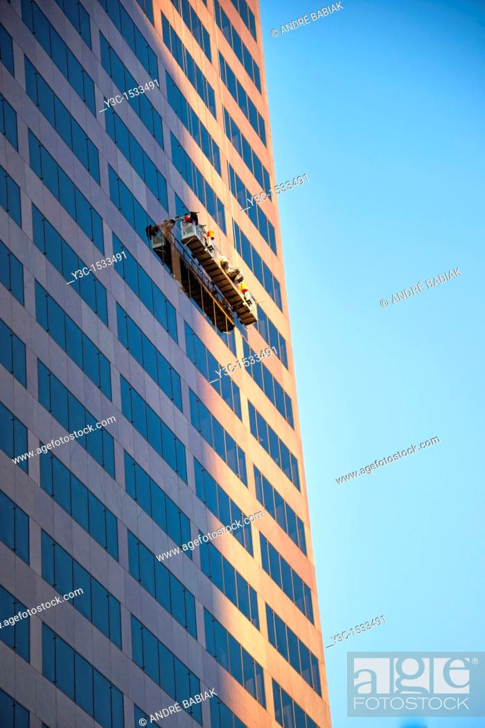 Stock Photo: Professional Window Cleaner at Downtown Denver, Colorado.