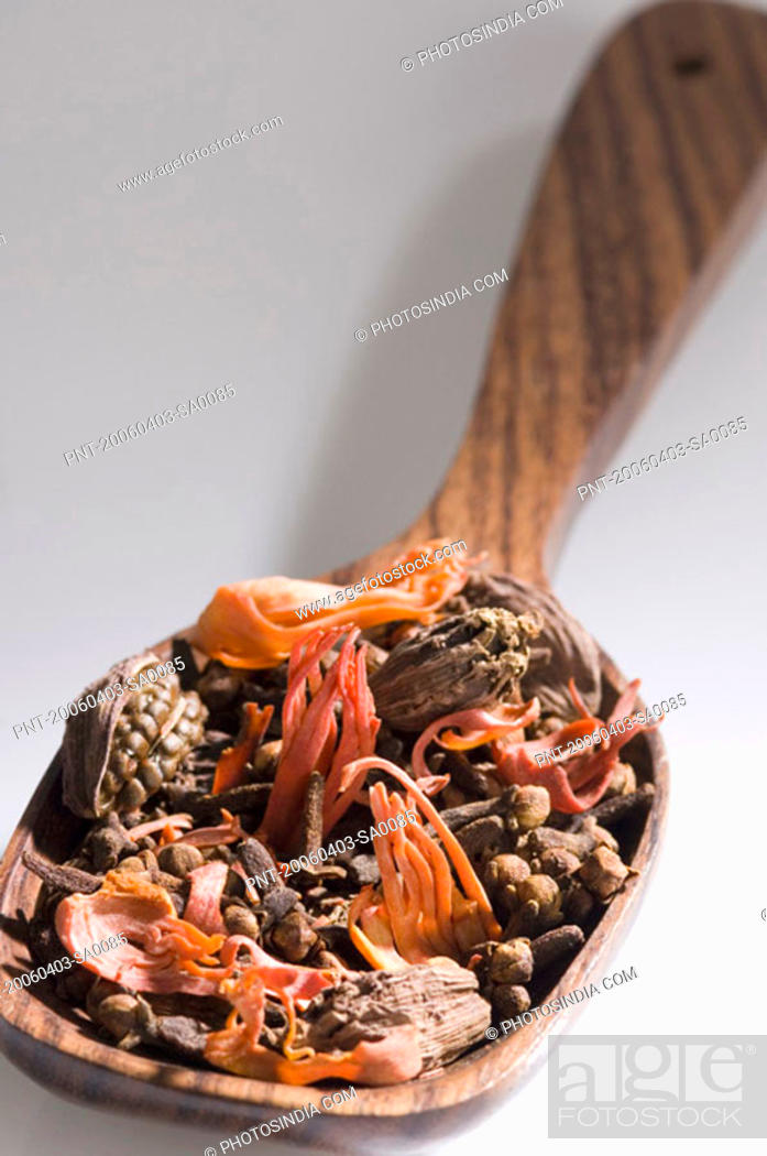 Stock Photo: Close-up of spices in a wooden spoon.