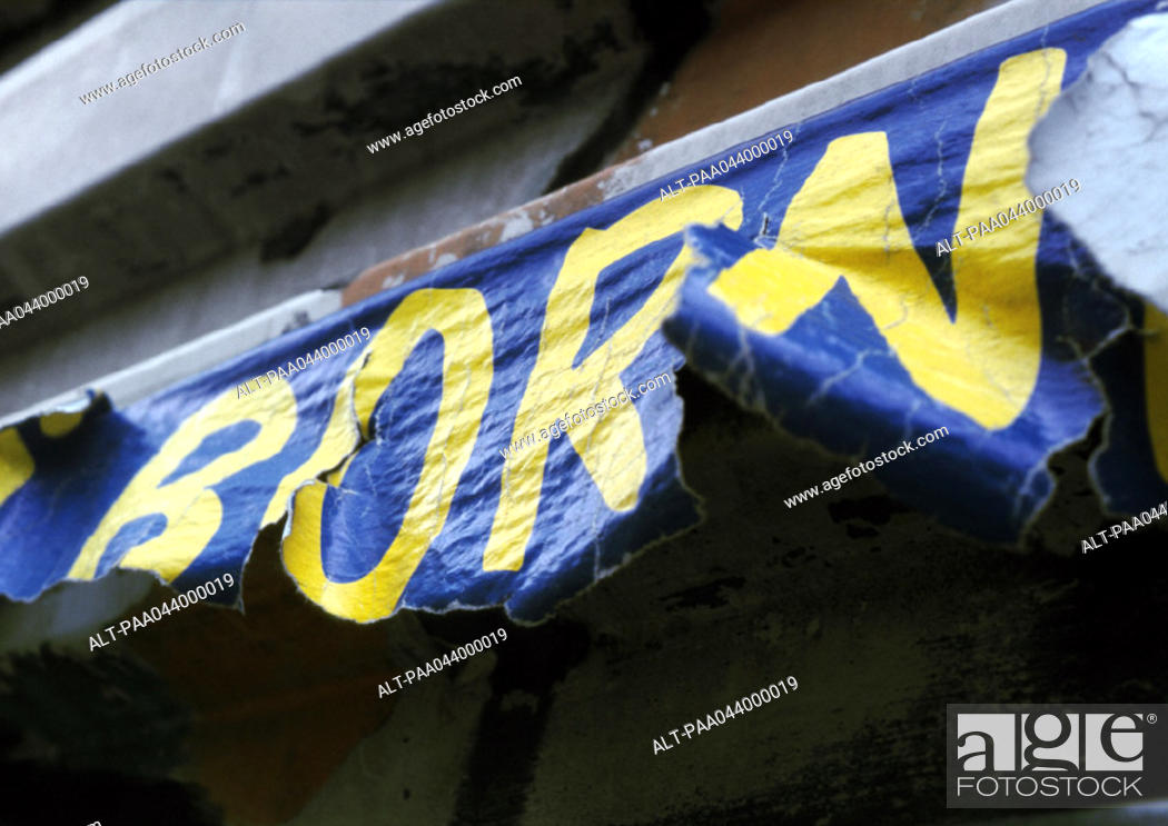 Stock Photo: 'Born' text on torn poster.