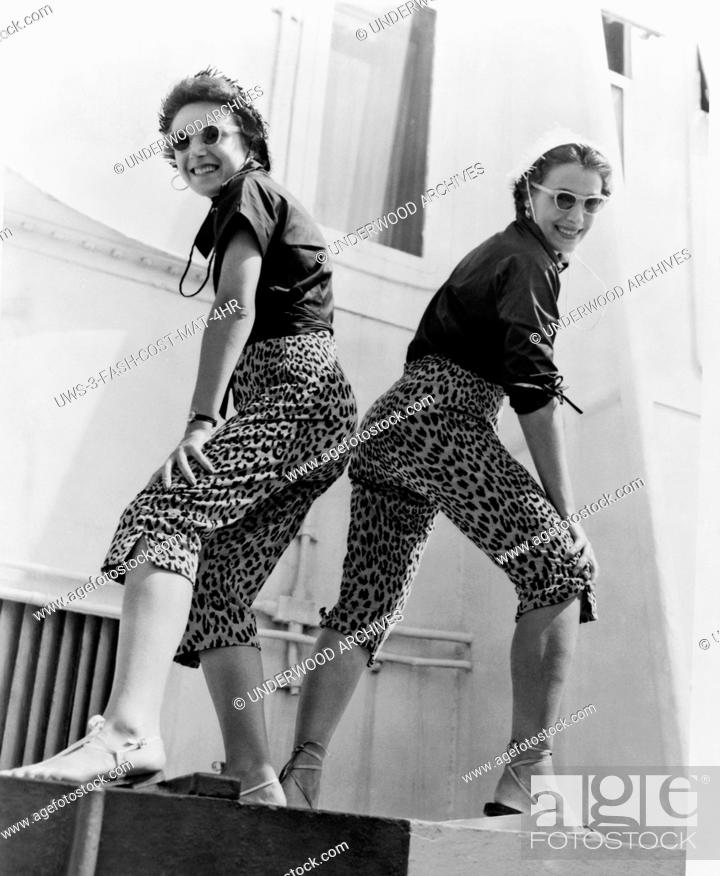 New York, New York: 1953 Two sisters sport matching leopard-skin