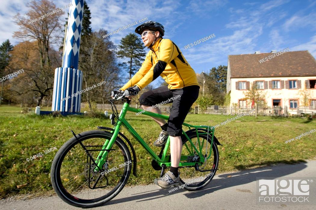 Stock Photo: Germany, Bavaria, Harmating, Mature man riding bicycle.