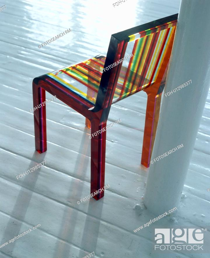 Close Up Of Multi Coloured Striped Perspex Dining Chair On White Wooden Flooring Stock Photo Picture And Rights Managed Image Pic Foh U12985377 Agefotostock