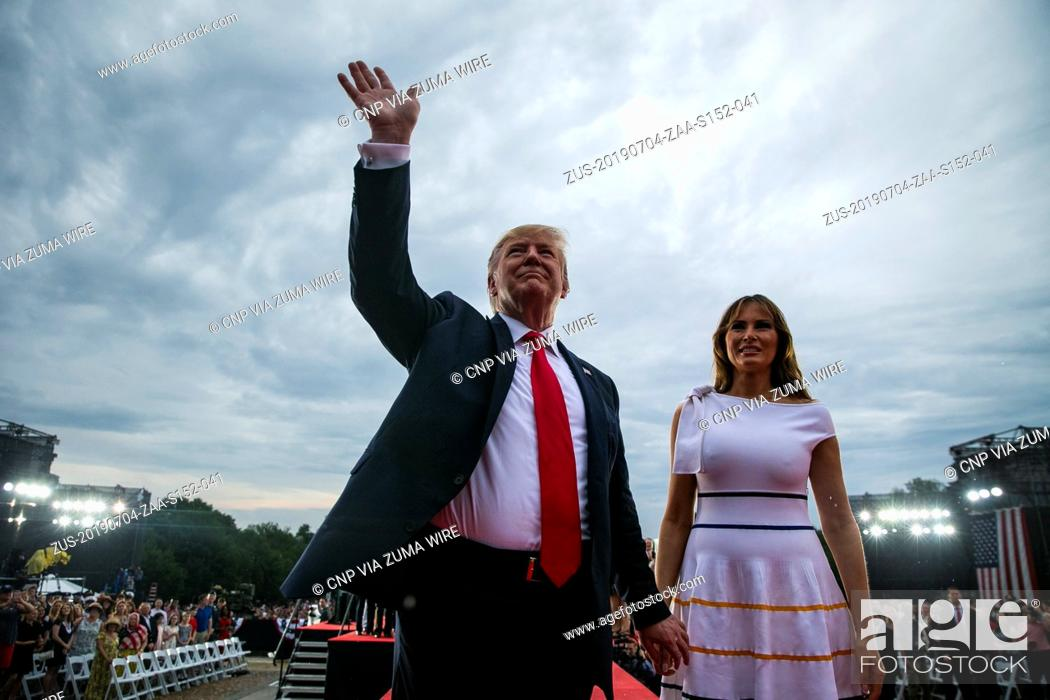 Stock Photo: July 4, 2019, Washington, District of Columbia, USA: U.S. President DONALD TRUMP waves with First Lady MELANIA TRUMP during the Fourth of July Celebration.