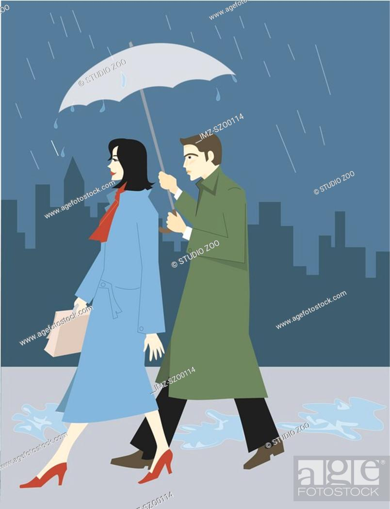 Stock Photo: A businessman holding an umbrella for a businesswoman.