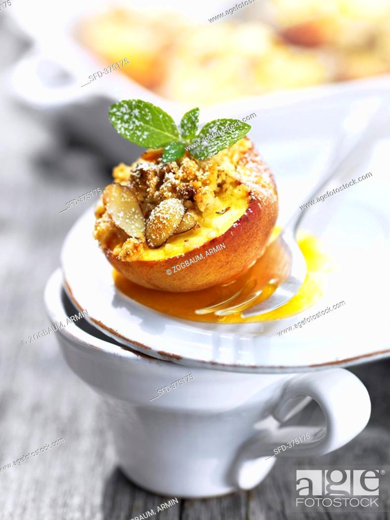 Stock Photo: Baked peach with almond crumble topping.