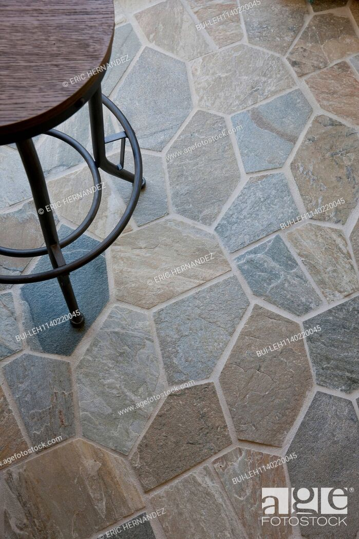 Imagen: Close-up of stone floor with cropped stool at home.