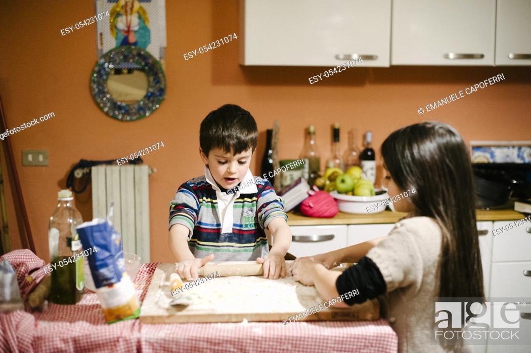 Stock Photo: Children prepare bread dough.