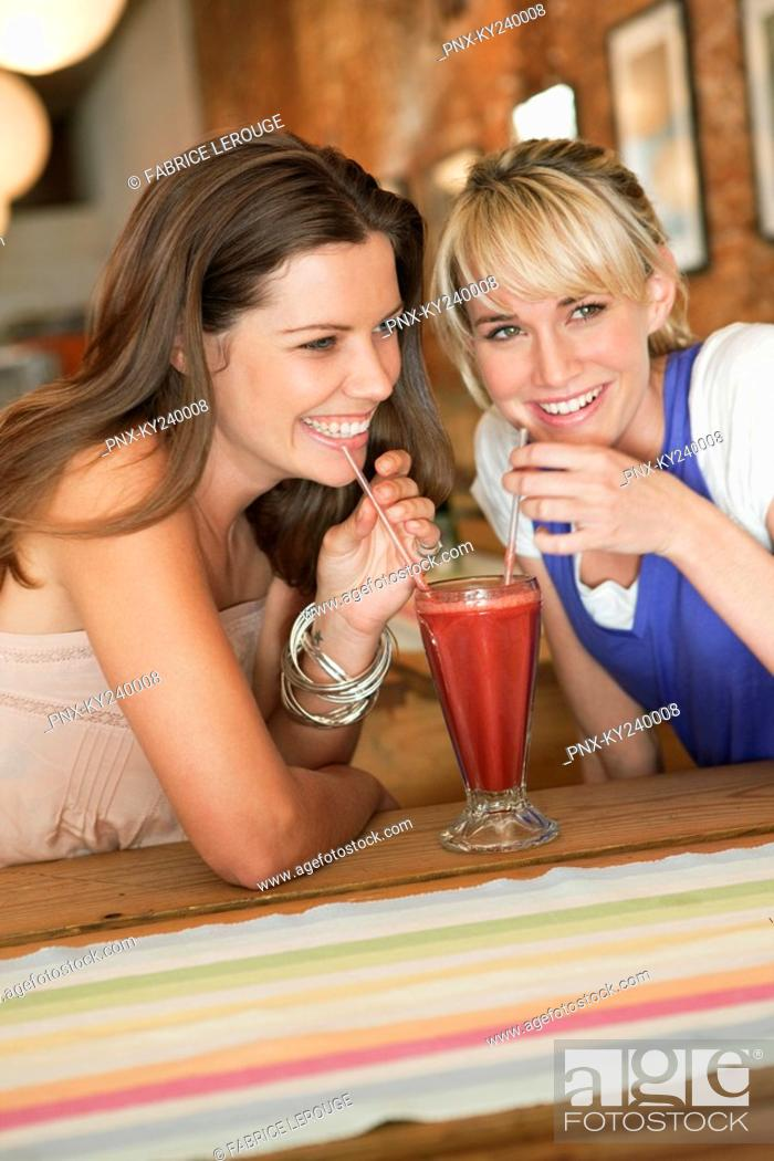 Stock Photo: Women drinking bloody mary in a cafe.