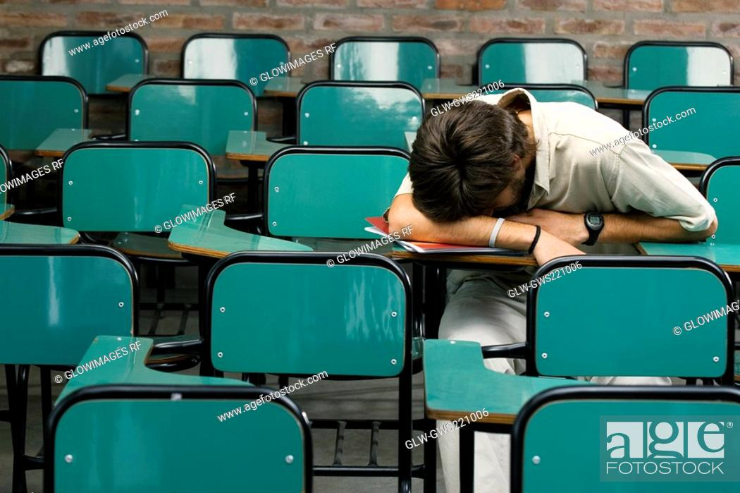 Stock Photo: Young man napping in a classroom.