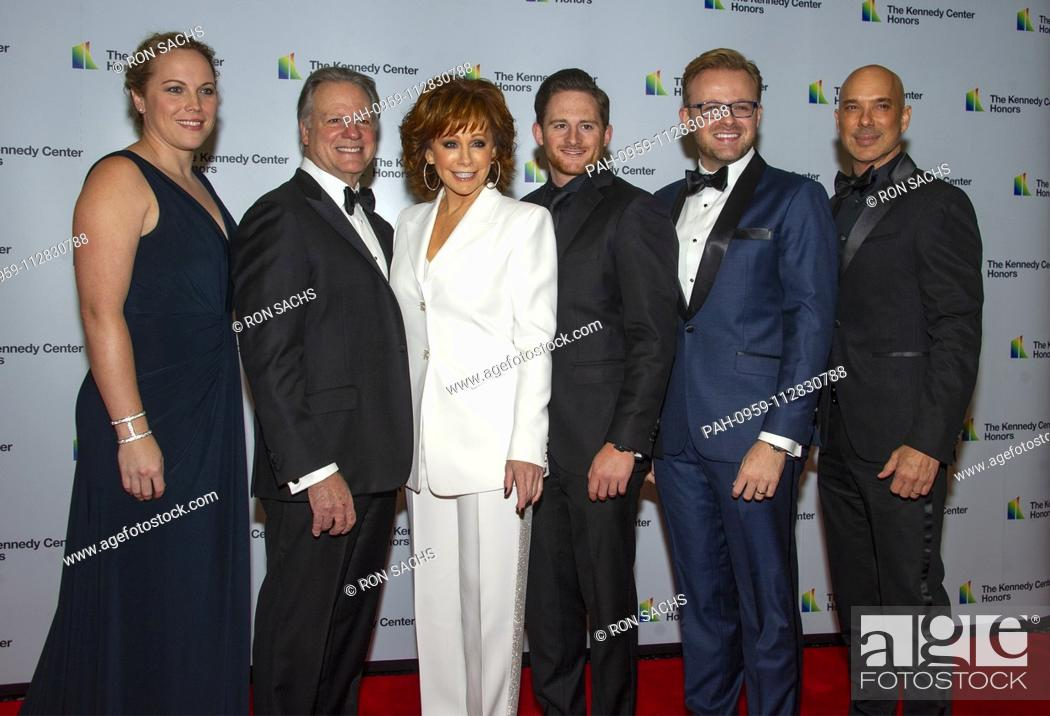 Stock Photo: Reba McEntire arrives with her family for the formal Artist's Dinner honoring the recipients of the 41st Annual Kennedy Center Honors hosted by United States.