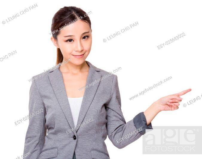 Stock Photo: Businesswoman finger point aside.