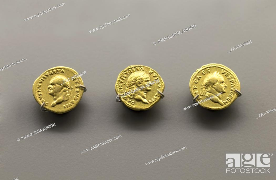 Stock Photo: Gold Roman Imperial coins bearing the bust of Emperor Vespasian. National Museum of Roman Art in Merida, Spain.