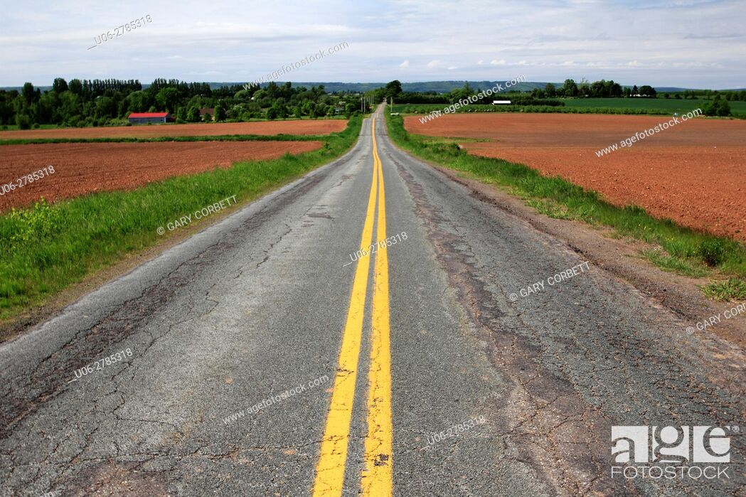 Stock Photo: an old paved road in the Annapolis Valley in Nova Scotia Canada.