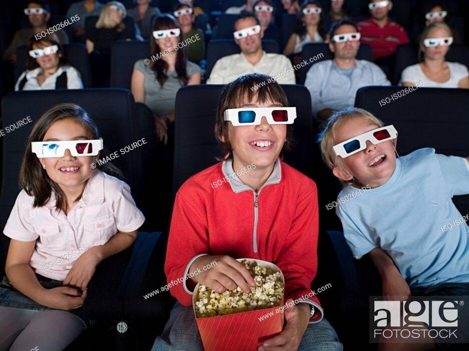 Stock Photo: Children watching a 3d movie.