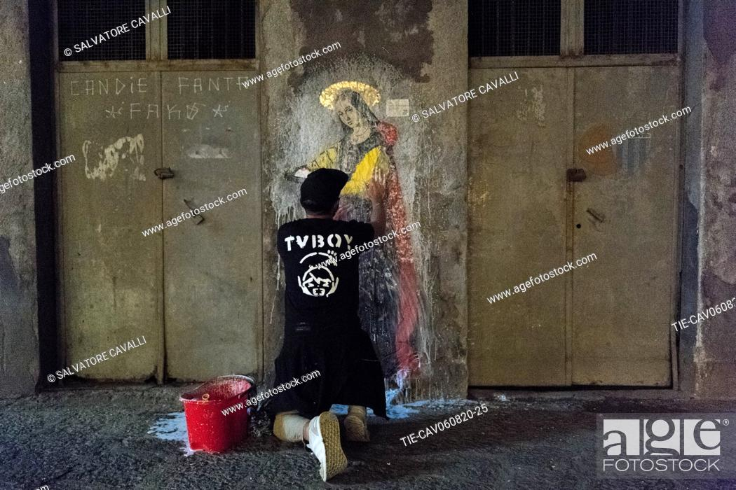 Stock Photo: The street artist TVBOY during the realization Finally, the third work Sant'Agata is a work of profound territorial significance.