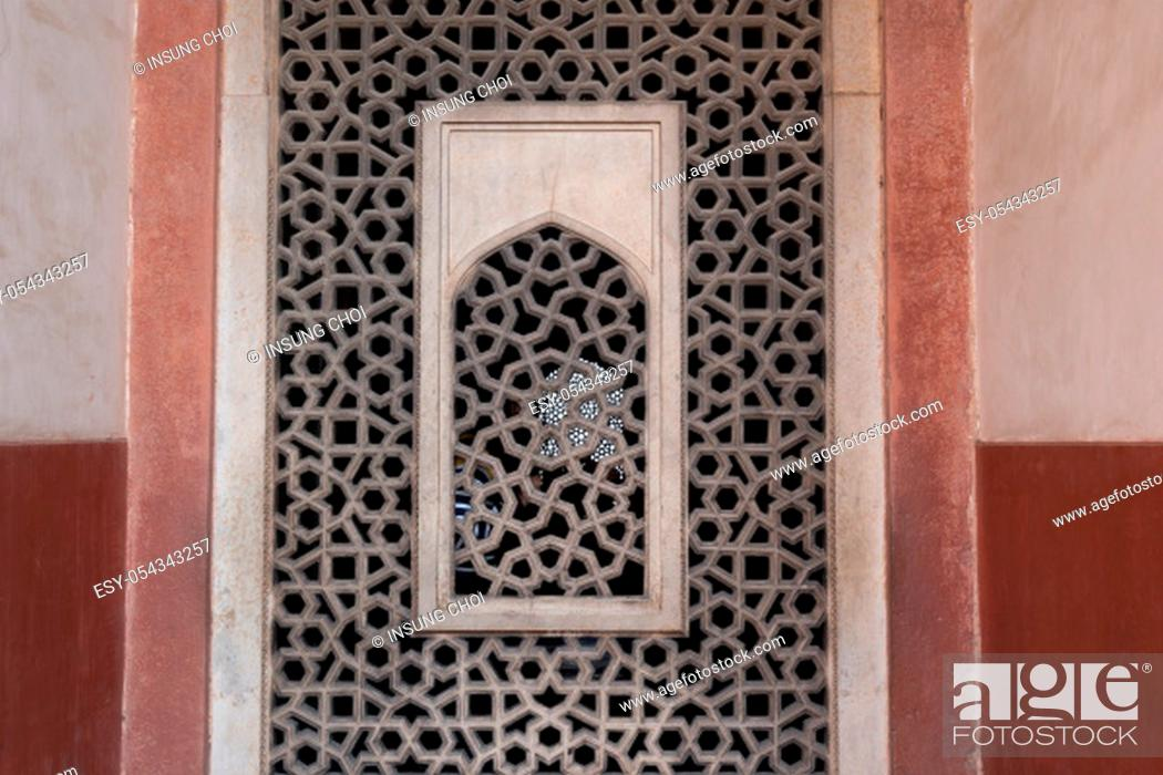 Stock Photo: patterned window of humayun's tomb complex in new delhi, india.