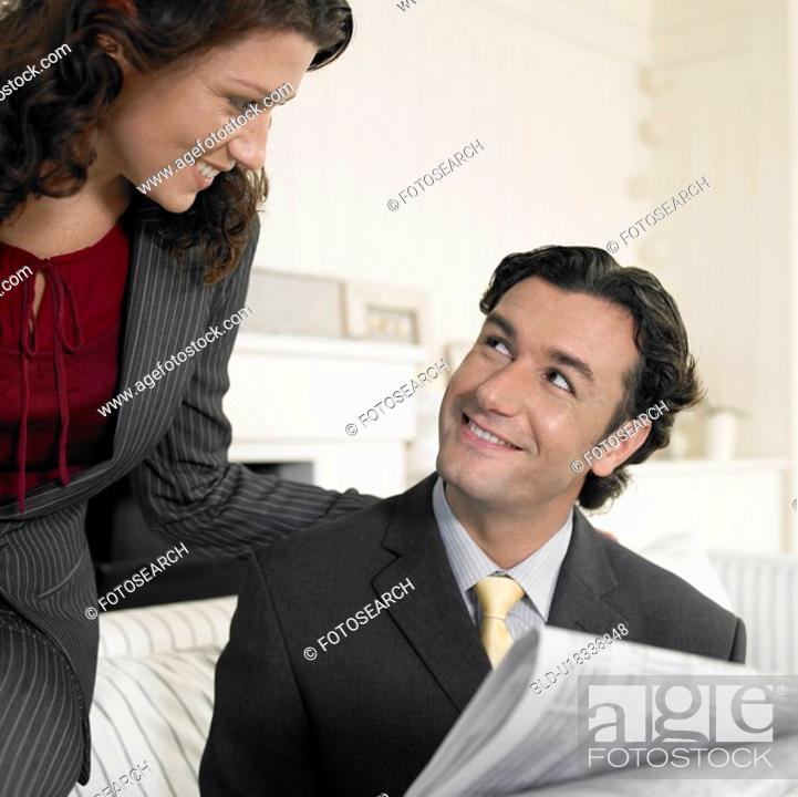 Stock Photo: Mid adult looking at each other.