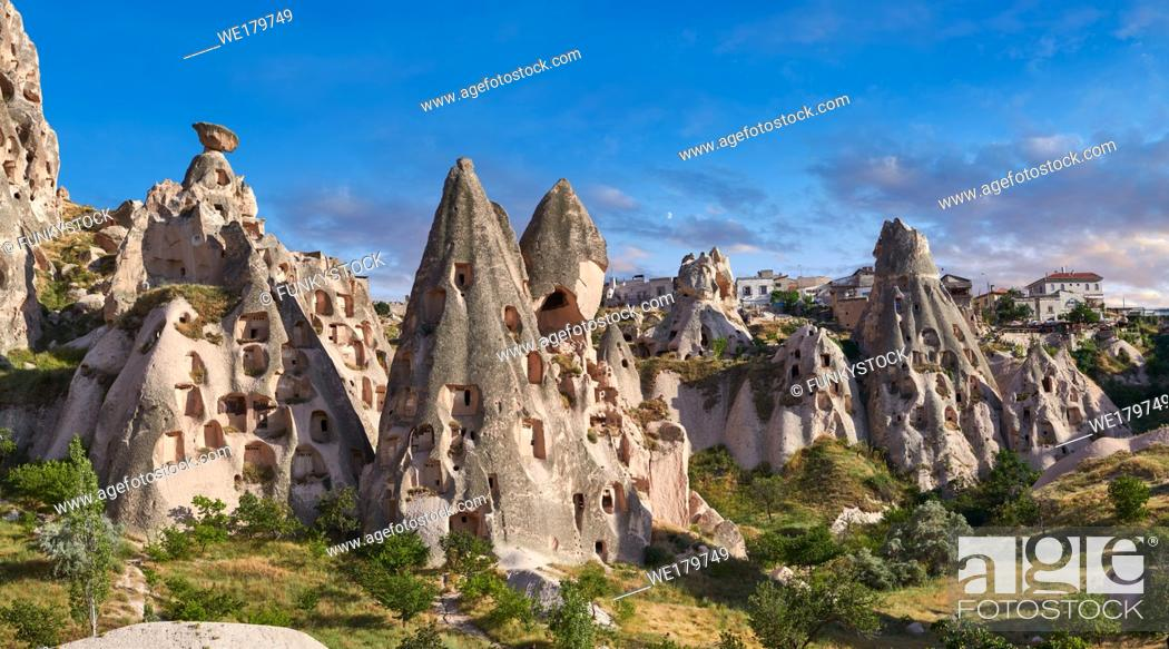 Stock Photo: Pictures & images of Uchisar Castle & the cave houses in the rock formations & fairy chimney of Uchisar, near Goreme, Cappadocia, Nevsehir, Turkey.