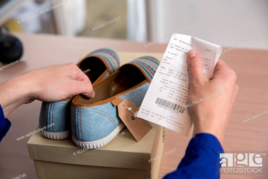 Stock Photo: Woman is returning shoes in a boutique.