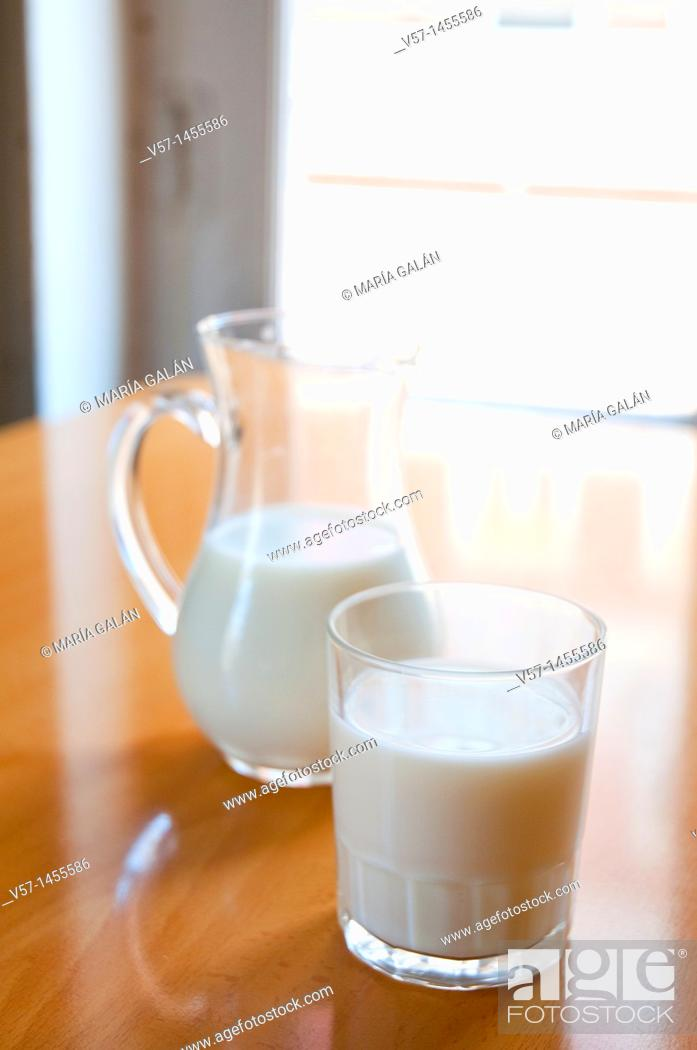 Stock Photo: Glass and jug of milk.