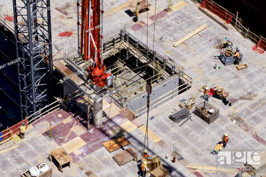 Stock Photo: Aerial view of workers at construction site.