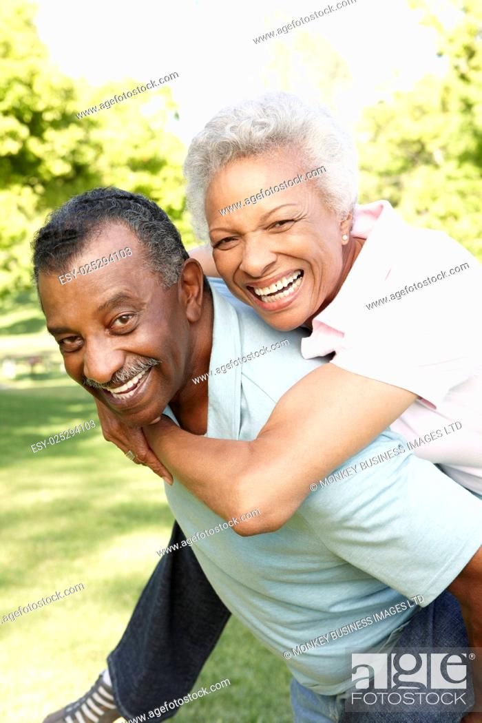 Stock Photo: Romantic African American Couple Having Fun In Park.
