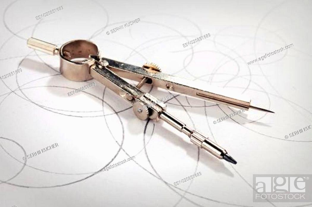Stock Photo: pair of compasses drawing.