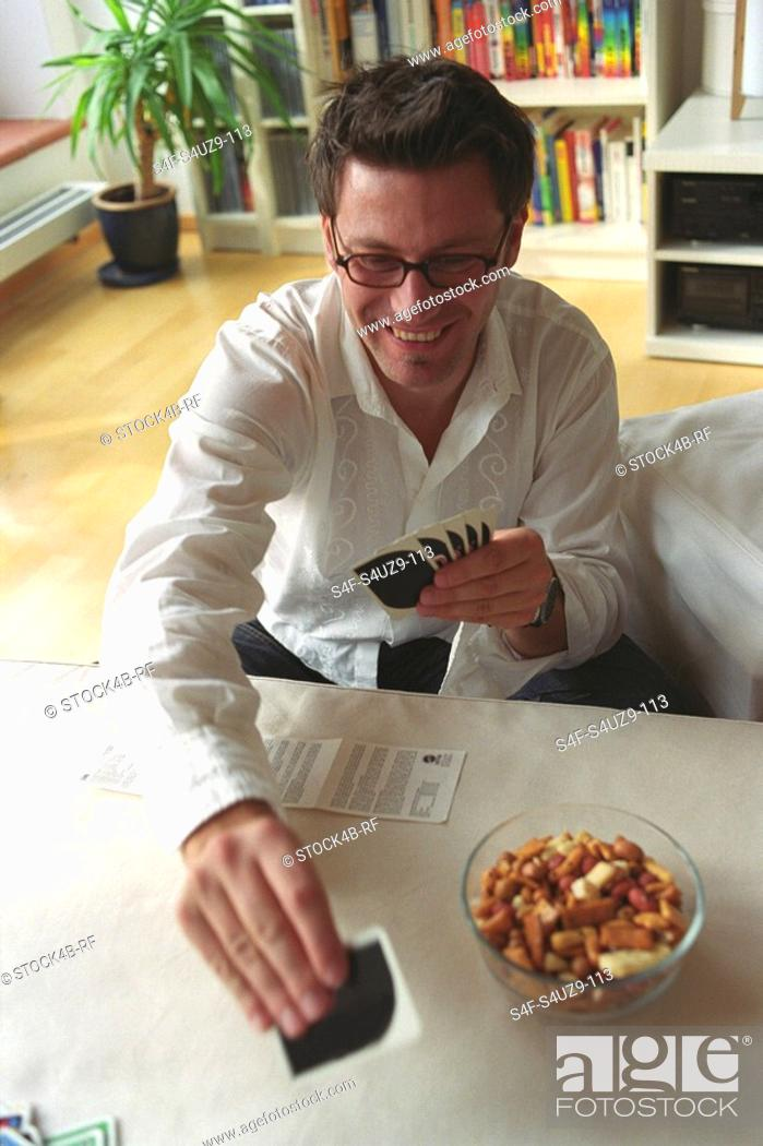 Stock Photo: Man holding Playing Cards.